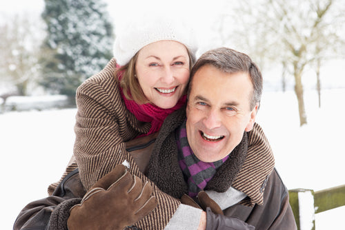 senior couple embracing in snowy outdoors