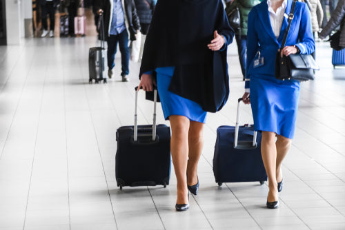 two stewardess walking