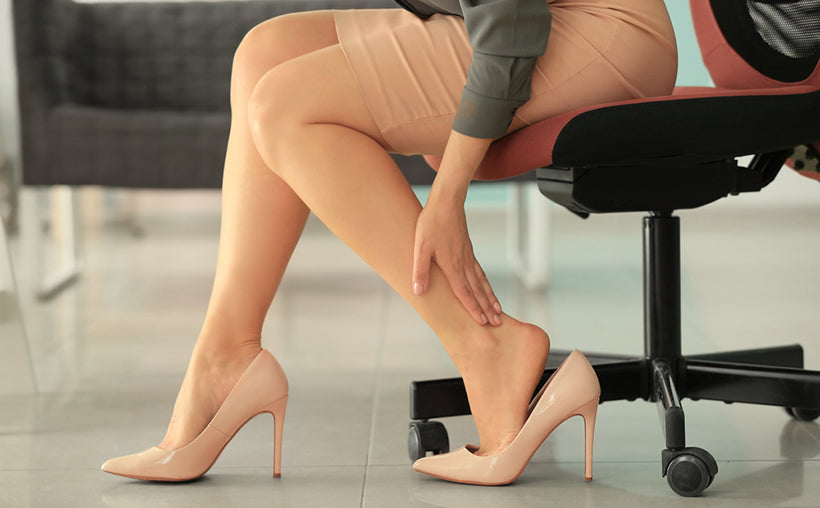 young woman leg pain high heels