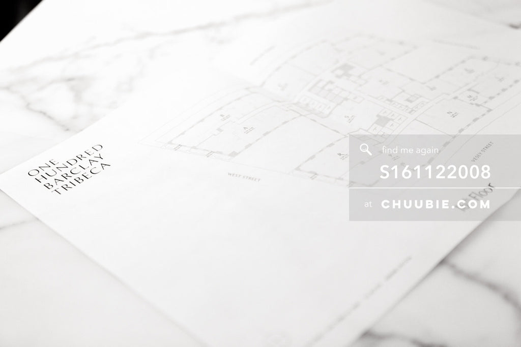 S161122008 |  FLOORPLAN on marble countertop. Soft-focus, atmospheric. 100 Barclay Street in Tribeca, New York... | Team Chuubie