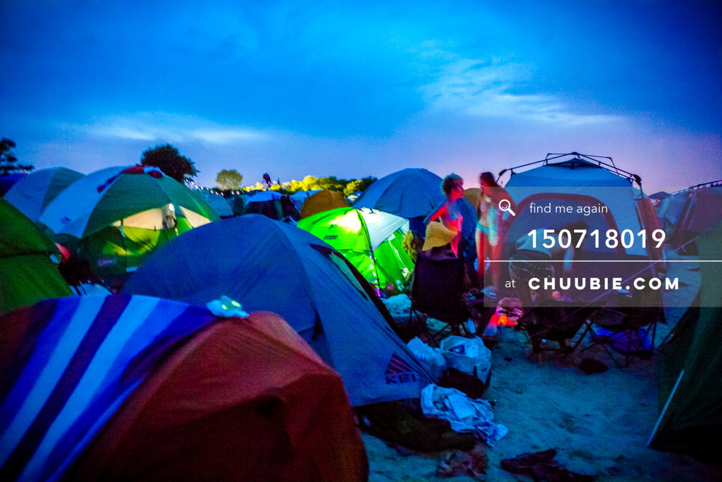 150718019 |  Vibrant sunset into evening colors with glowing green camping tents. —Gratitude Migration 2015: ... | Team Chuubie