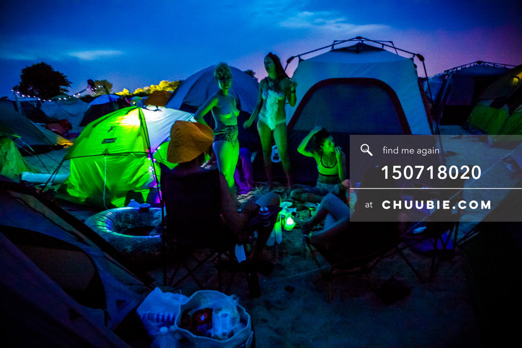 150718020 |  Vibrant sunset into evening colors with glowing green camping tents. —Gratitude Migration 2015: ... | Team Chuubie