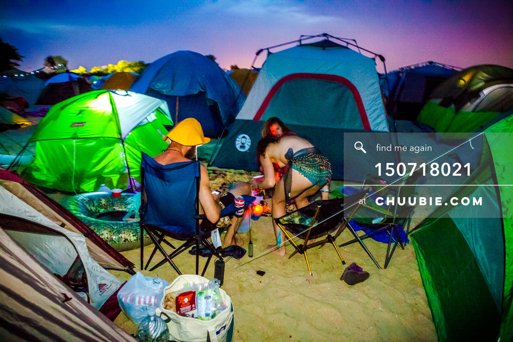 150718021 |  Campers settle in with vibrant saturated blue-magenta sunset at regional Burning Man festival. —... | Team Chuubie
