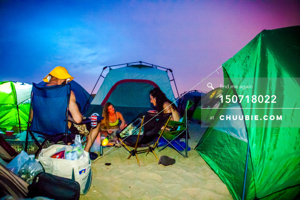 150718022 |  Campers settle in with magnificent vibrant saturated blue-magenta sunset at regional Burning Man... | Team Chuubie