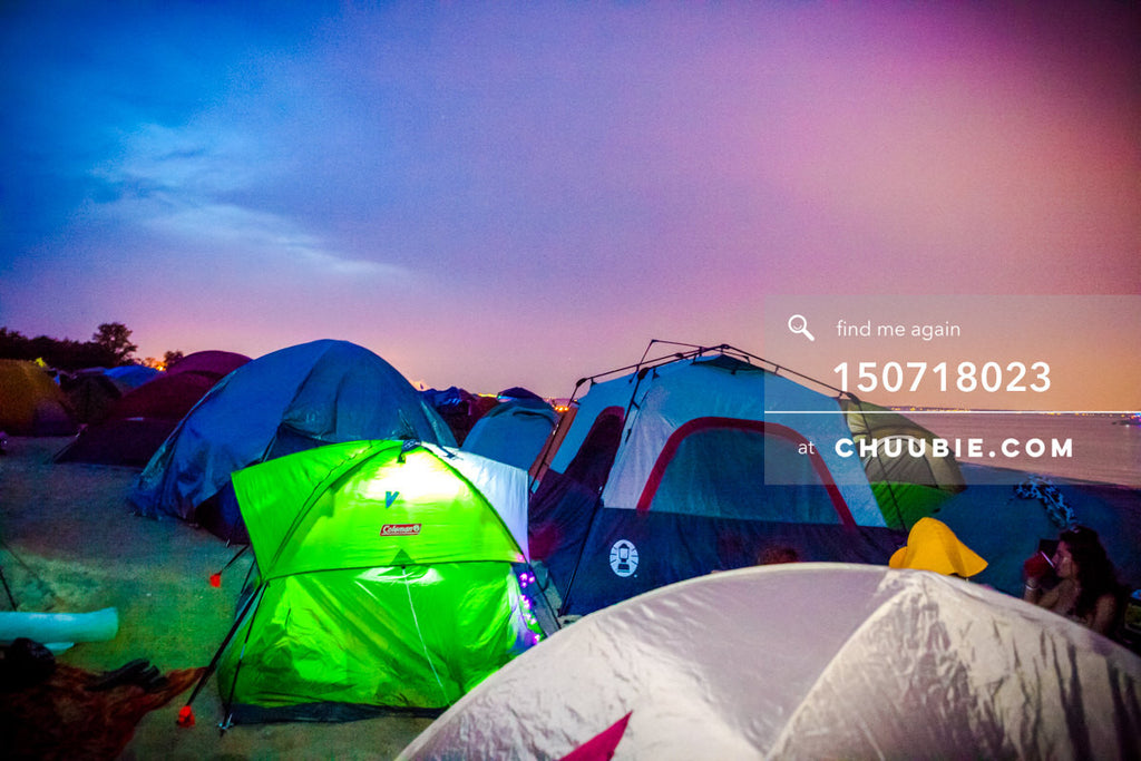 150718023 |  Scenic landscape of camping tents against magnificent vibrant saturated blue-magenta sunset at r... | Team Chuubie