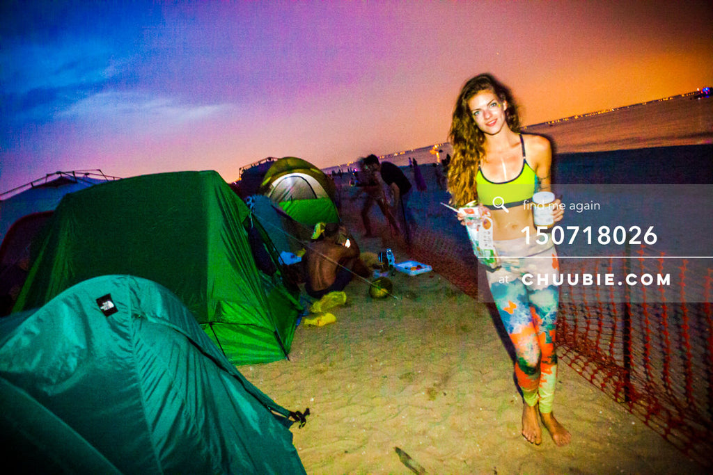 150718026 |  Athletic & sporty Rachel Precious stands with camp tents against a stunning and vibrant blue... | Team Chuubie