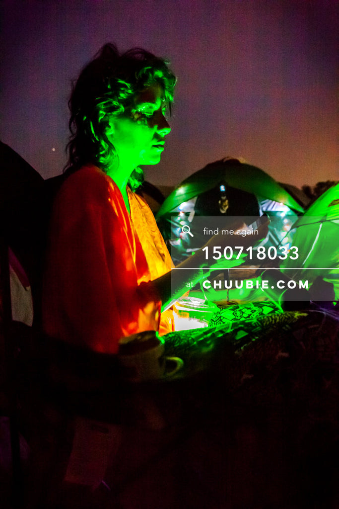 150718033 |  Green glowing alien Tash Kouri at beach campsite sunset. —Gratitude Migration 2015: Summer Dream... | Team Chuubie