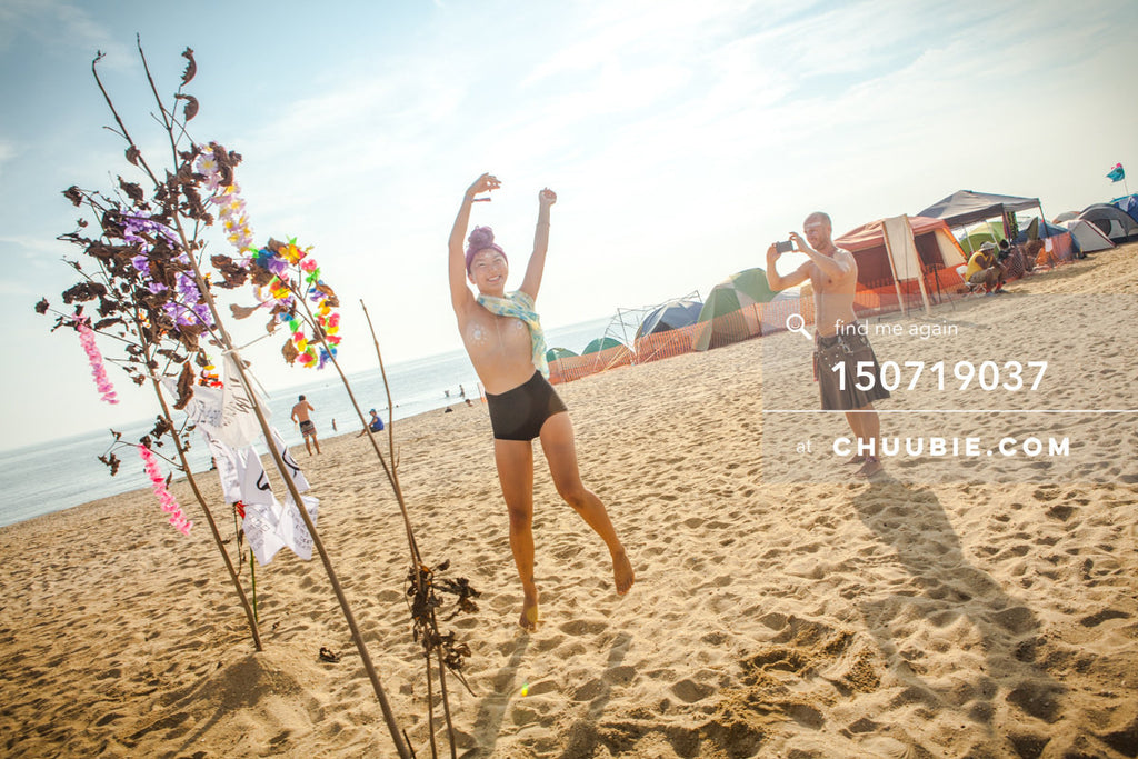 150719037 |  Poppy dances on beach while Ryan snaps a photo. —Gratitude Migration 2015: Summer Dream. Morning... | Team Chuubie