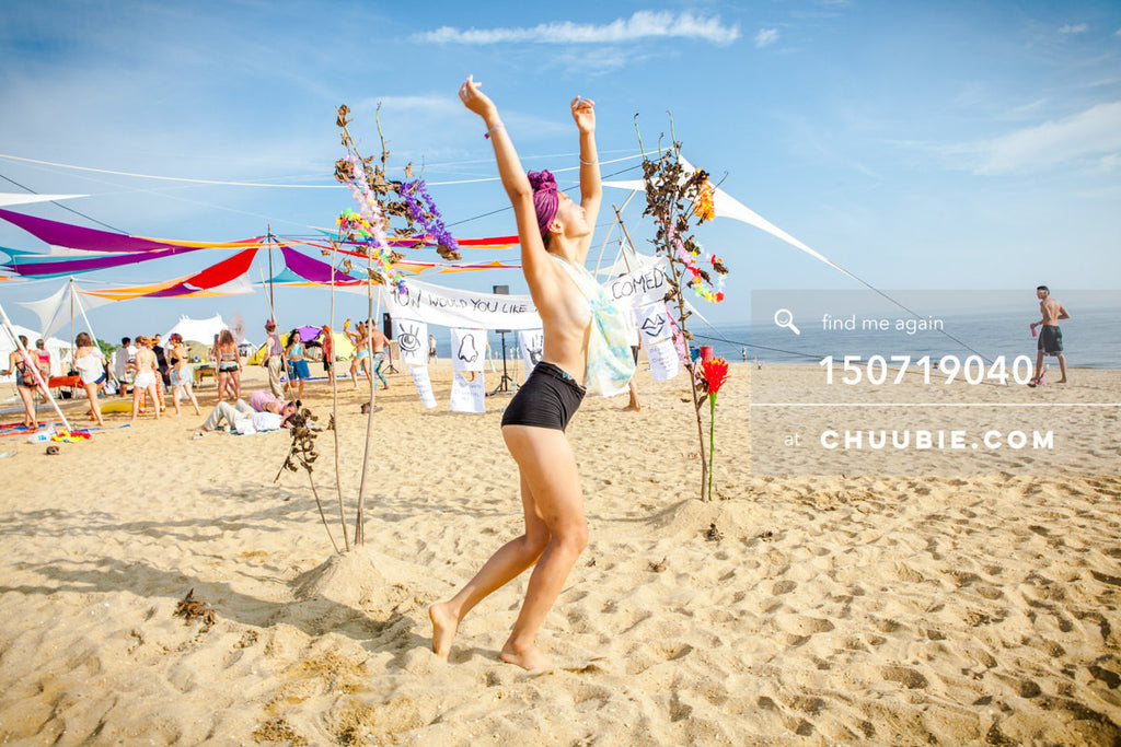 150719040 |  Artist Poppy Liu free spirit dances in front of her welcome experience installation. —Gratitude ... | Team Chuubie