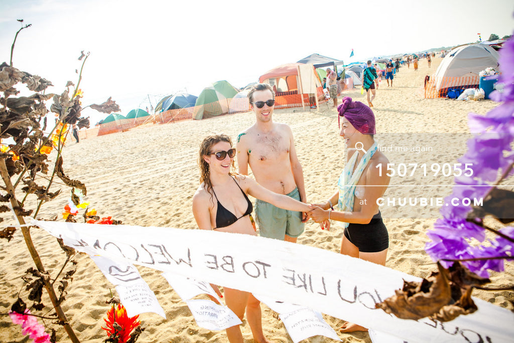150719055 |  Artist Poppy provides welcoming experience on the beach playa. —Gratitude Migration 2015: Summer... | Team Chuubie