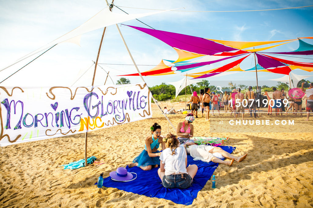 150719059 |  Ladies from Morning Gloryville provide guided meditations on the beach playa. —Gratitude Migrati... | Team Chuubie