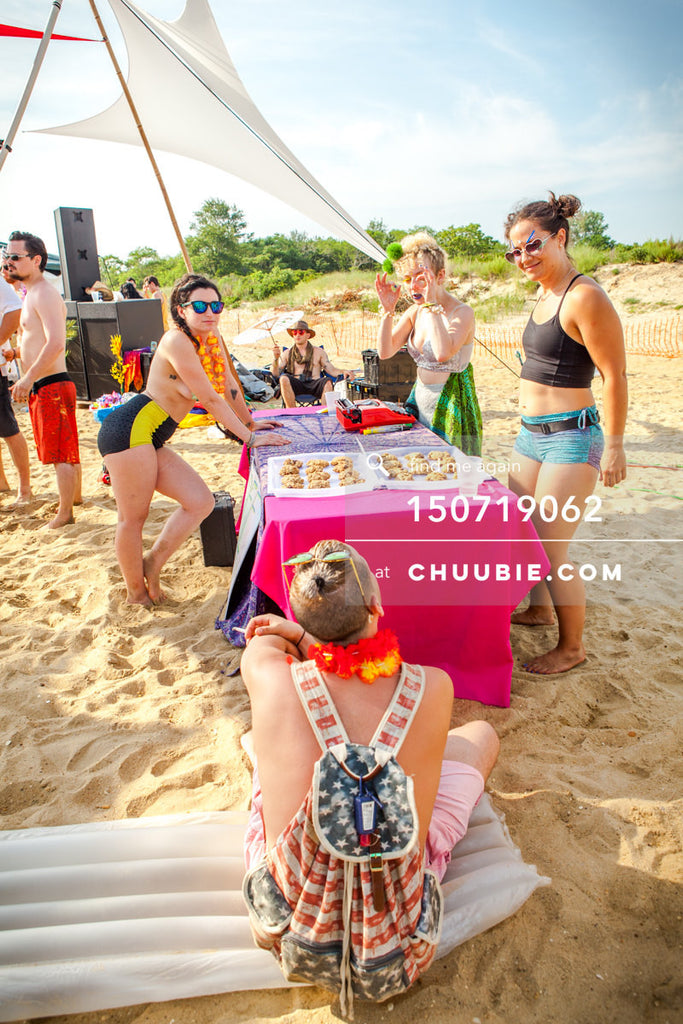 150719062 |  Massage table experiences in open air pavilion tent on the beach playa. —Gratitude Migration 201... | Team Chuubie
