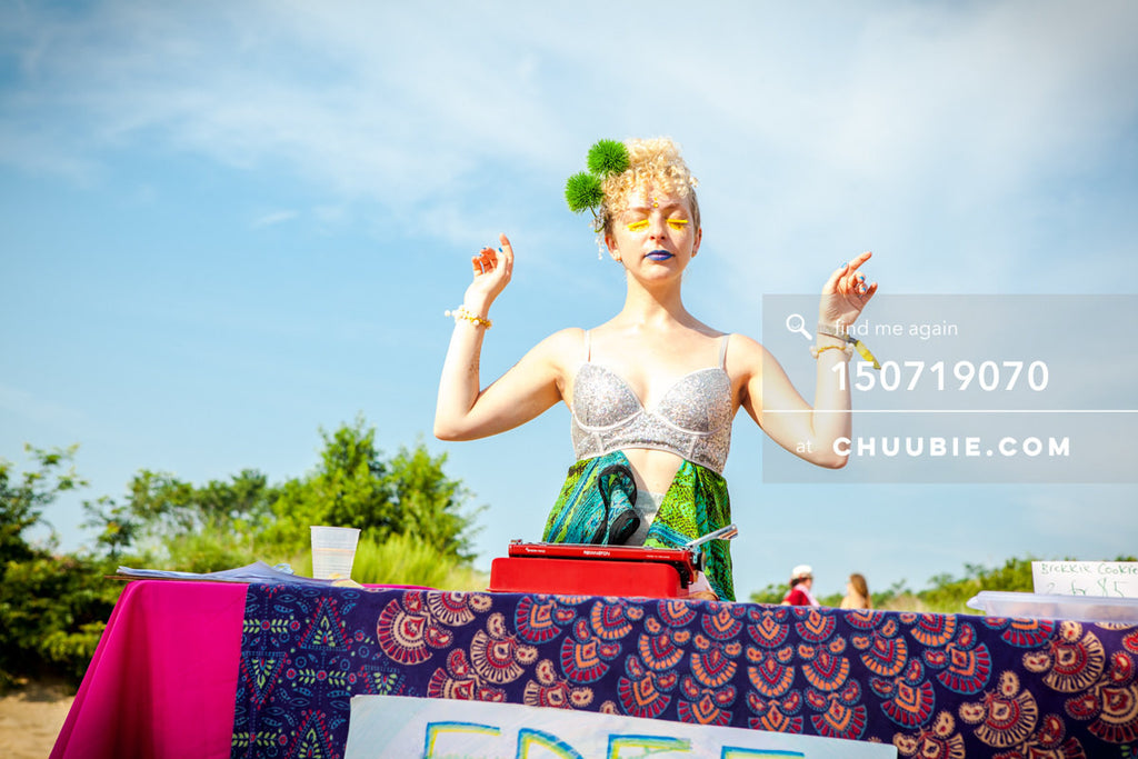 150719070 |  Poet Tania Asnes is art statuesque at the Free Haiku beach table. —Gratitude Migration 2015: Sum... | Team Chuubie