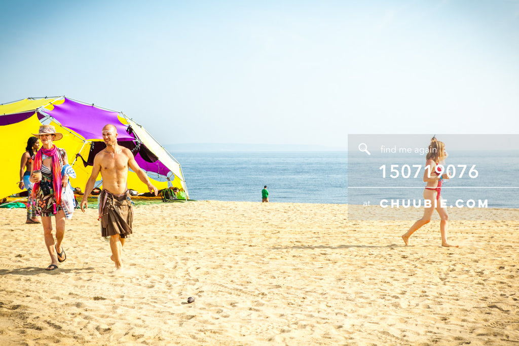 150719076 |  Ryan walks with other burners along playa beach. —Gratitude Migration 2015: Summer Dream. Mornin... | Team Chuubie