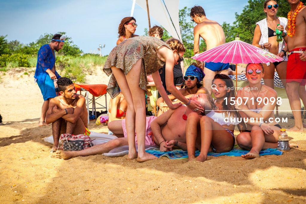 150719098 |  Surfer girl and friends take shade under parasol at beach party. —Gratitude Migration 2015: Summ... | Team Chuubie