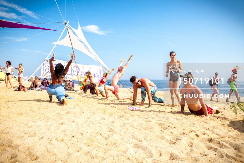 150719101 |  Crescent moon pose at group beach yoga sessions! —Gratitude Migration 2015: Summer Dream. Mornin... | Team Chuubie