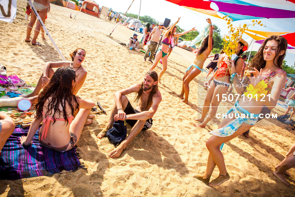 150719121 |  Group of attendees relaxing celebrating regional beach Burning Man festival. —Gratitude Migratio... | Team Chuubie