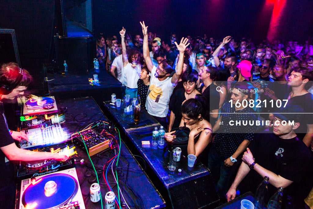 160821107 |  Side view: Ben UFO (Ben Thomson) DJing with packed crowd dancing arms up in the air. Electric Mi... | Team Chuubie