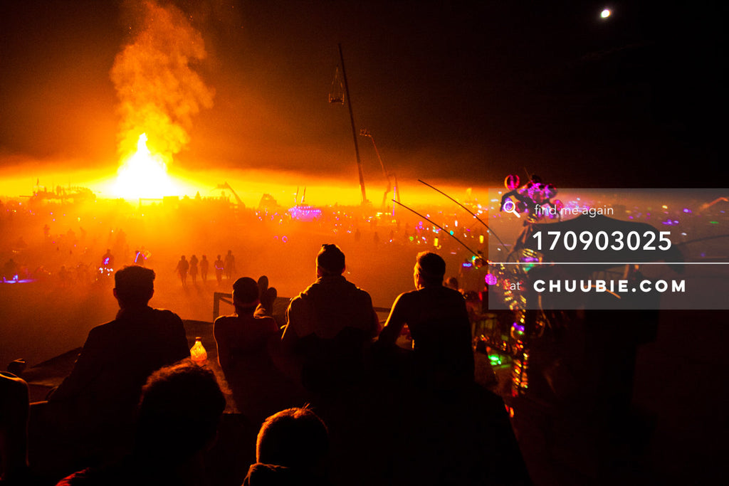 170903025 |  The boys of BAAAHS camp sit atop art car watching the Temple Burn in the distance. —Burning Man ... | Team Chuubie