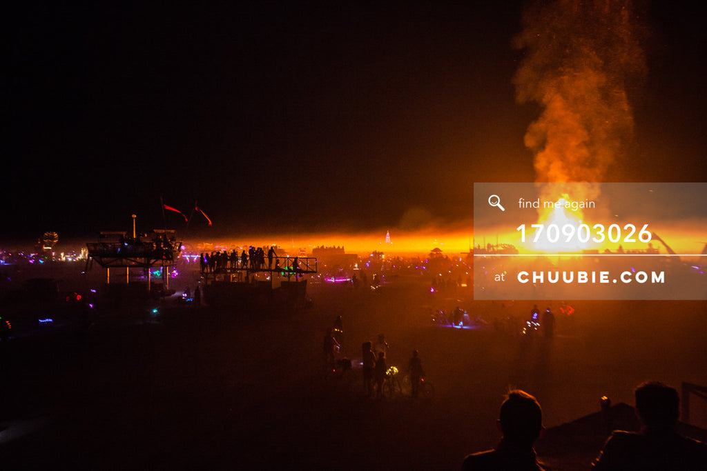 170903026 |  Post-apocalyptic landscape of burners and art cars silhouetted by the Temple Burn, photographed ... | Team Chuubie