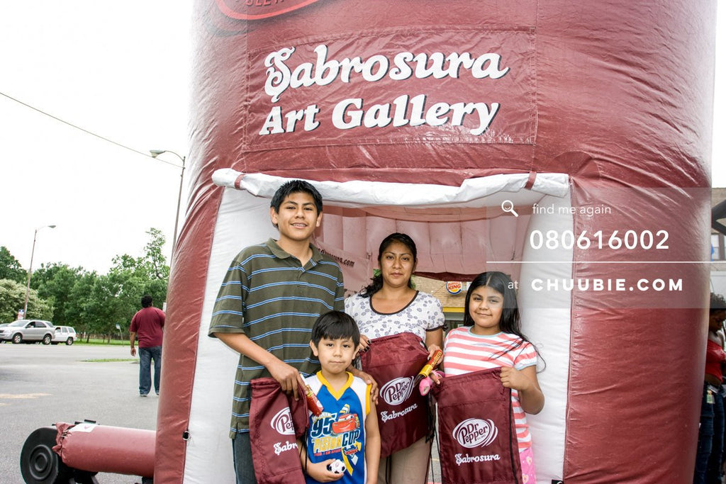 80613002 |  Family showcases their drawstring bag prizes  —Dr. Pepper Sabrosura mobile tour event photograph... | Team Chuubie