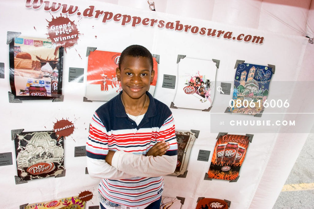 80613006 |  Boy poses in front of the Sabrosura art contest winning pieces.  —Dr. Pepper Sabrosura mobile to... | Team Chuubie