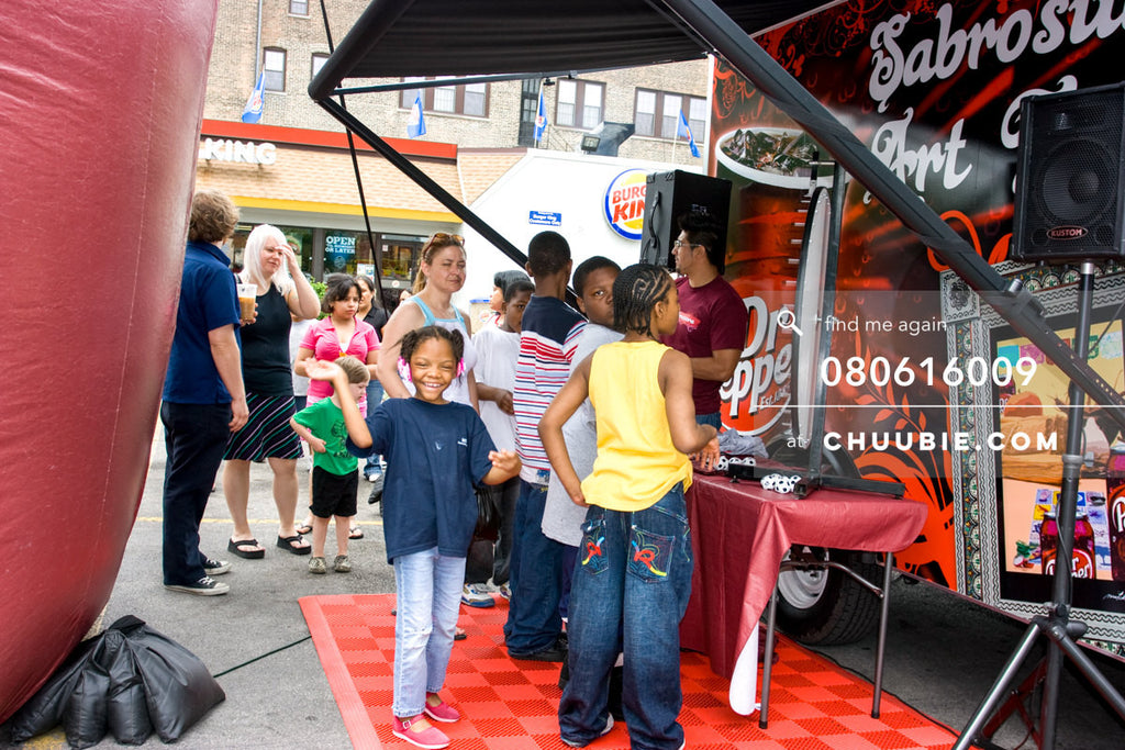 080613009 |  Local Chicago residents line up to spin the prize wheel.  —Dr. Pepper Sabrosura mobile tour even... | Team Chuubie