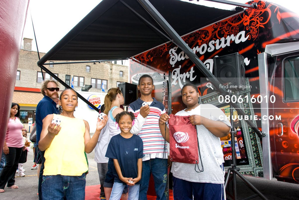 80613010 |  Local Chicago residents stand in front of the mobile tour van with their prizes.  —Dr. Pepper Sa... | Team Chuubie