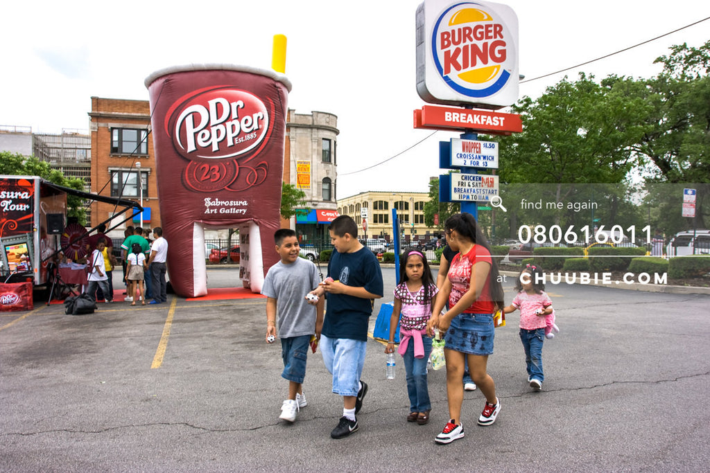 080613011 |  Group of kids walking away from the inflatable art gallery with their prizes. Burger King sign i... | Team Chuubie