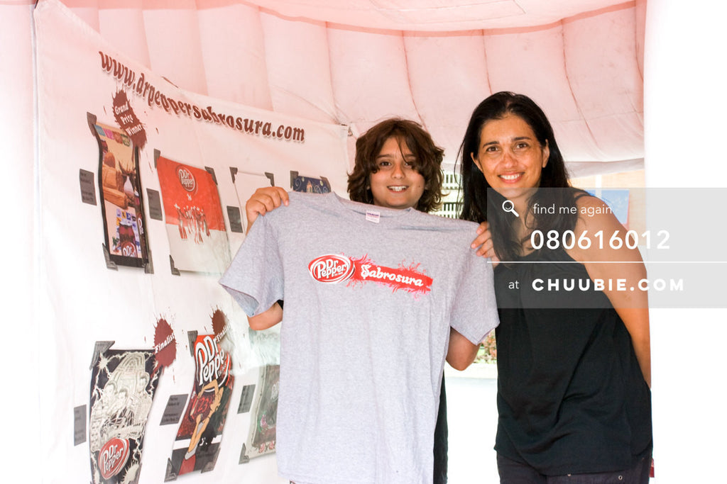 080613012 |  Mother with son holding his Sabrosura t-shirt!  —Dr. Pepper Sabrosura mobile tour event photogra... | Team Chuubie