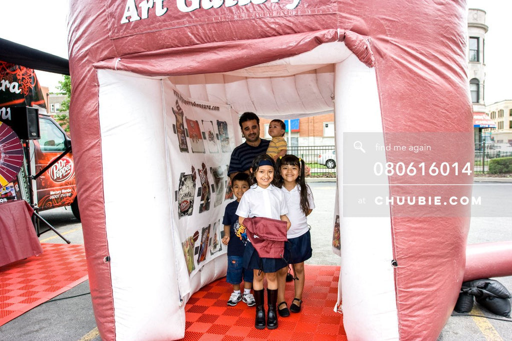 80613014 |  Father and his four children stand inside the inflatable art gallery.  —Dr. Pepper Sabrosura mob... | Team Chuubie