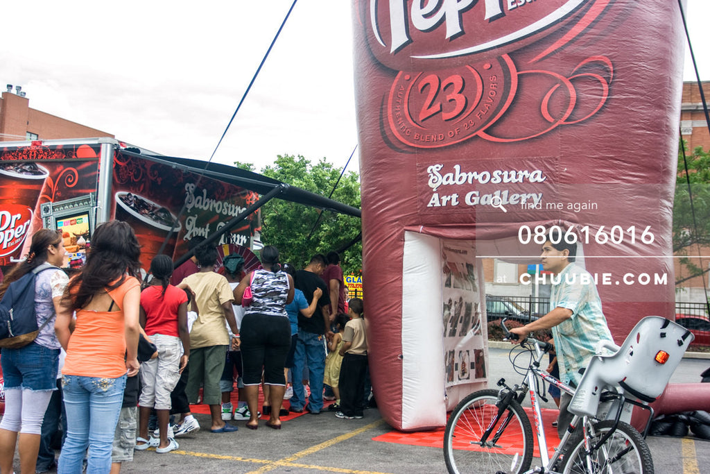 080613016 |  Families line up to spin the prize wheel.  —Dr. Pepper Sabrosura mobile tour event photography. ... | Team Chuubie