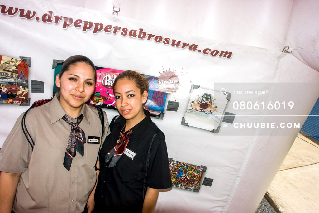 080613019 |  Two ladies from the Burger King staff stop into the inflatable art gallery.  —Dr. Pepper Sabrosu... | Team Chuubie