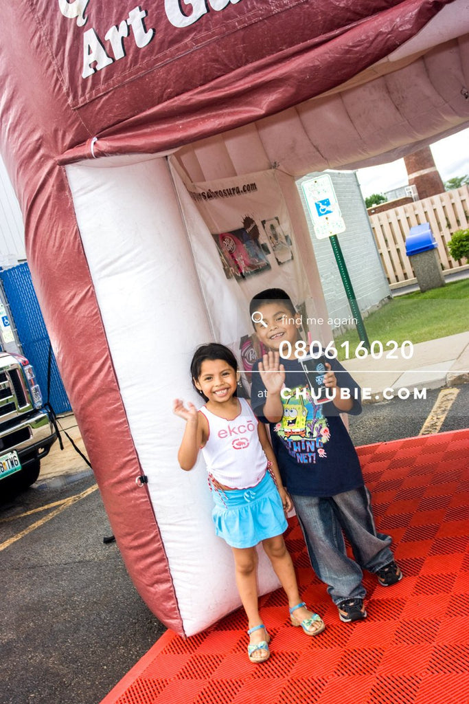 80613020 |  Little girl and boy wave with smiles from the inflatable art gallery.  —Dr. Pepper Sabrosura mob... | Team Chuubie