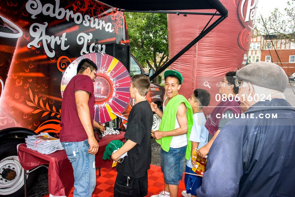 80613024 |  Young teen boys spinning the prize wheel.  —Dr. Pepper Sabrosura mobile tour event photography. ... | Team Chuubie