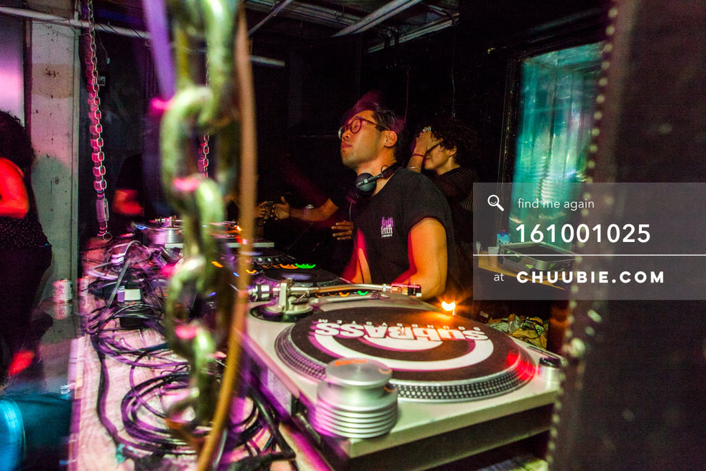 161001025 |  Side angle shot of HUNEE behind the DJ booth. Sublimate presents: Hunee September 30, 11pm - Oct... | Team Chuubie