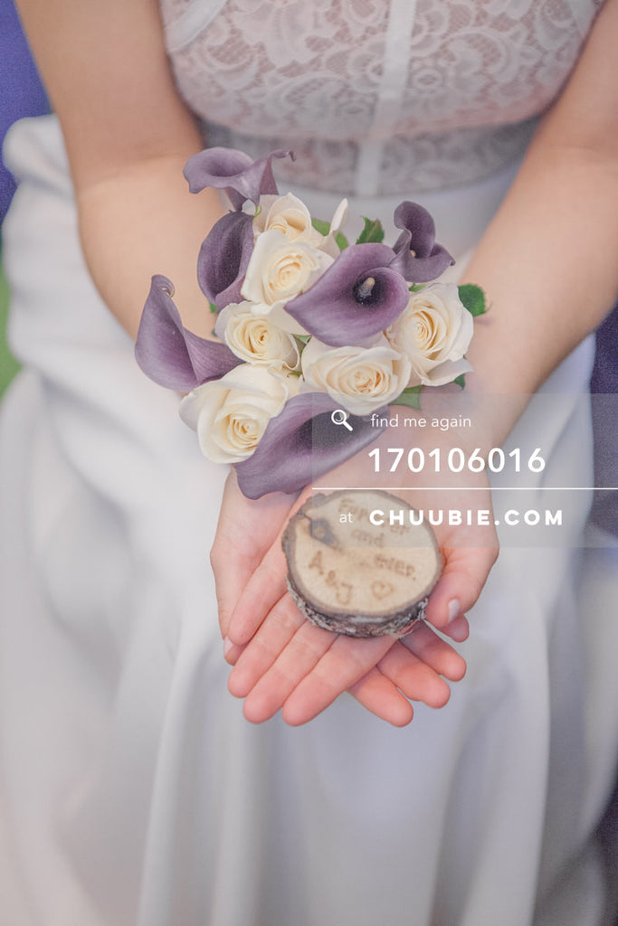 170106016 | Bride holds lavender & yellow bouquet of flowers; and special custom inscribed wedding ring b... | Team Chuubie