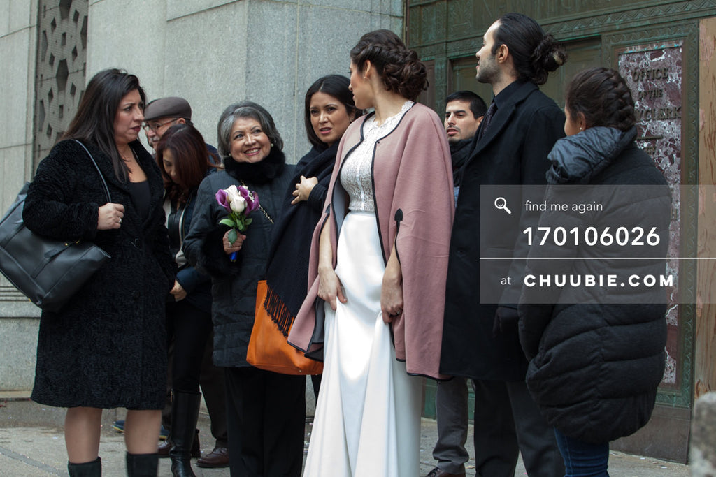 170106026 | Cinematic shot of Bride & Groom standing with families bundled in winter coats outside NYC Ci... | Team Chuubie