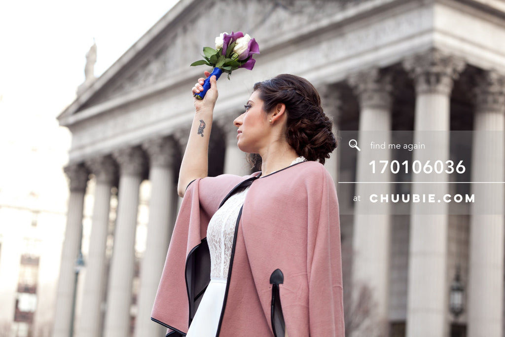170106036 | Bride raises bouquet in front of NYC City Hall building in background —Jenn & Andres' NYC Cit... | Team Chuubie
