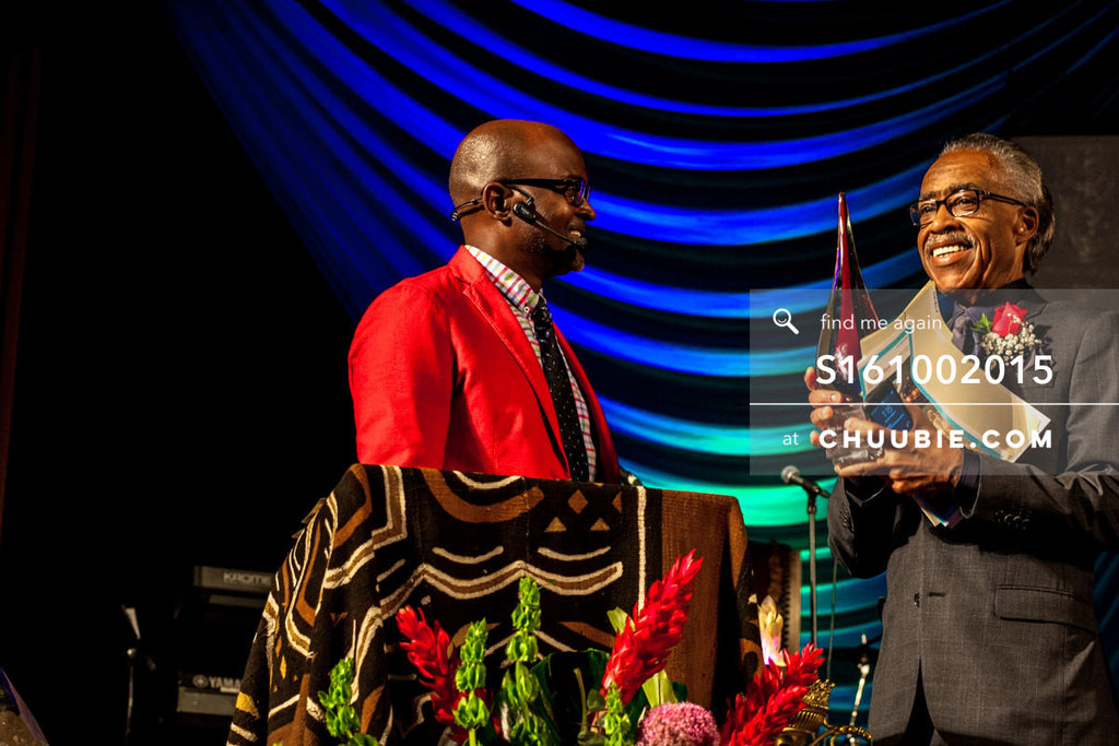S161002015 | Reverend Al Sharpton smiling, accepting award from Bishop Xavier Eikerenkoetter on behalf of Unit... | Team Chuubie