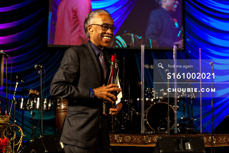 S161002021 | Reverend Al Sharpton mid-moment smiling on stage at United Palace; photographed in New York on Oc... | Team Chuubie