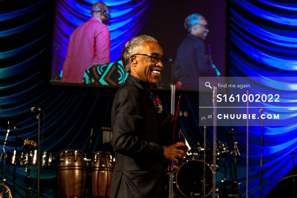 S161002022 | Reverend Al Sharpton mid-moment smiling turned 3/4 side profile on stage at United Palace; photog... | Team Chuubie