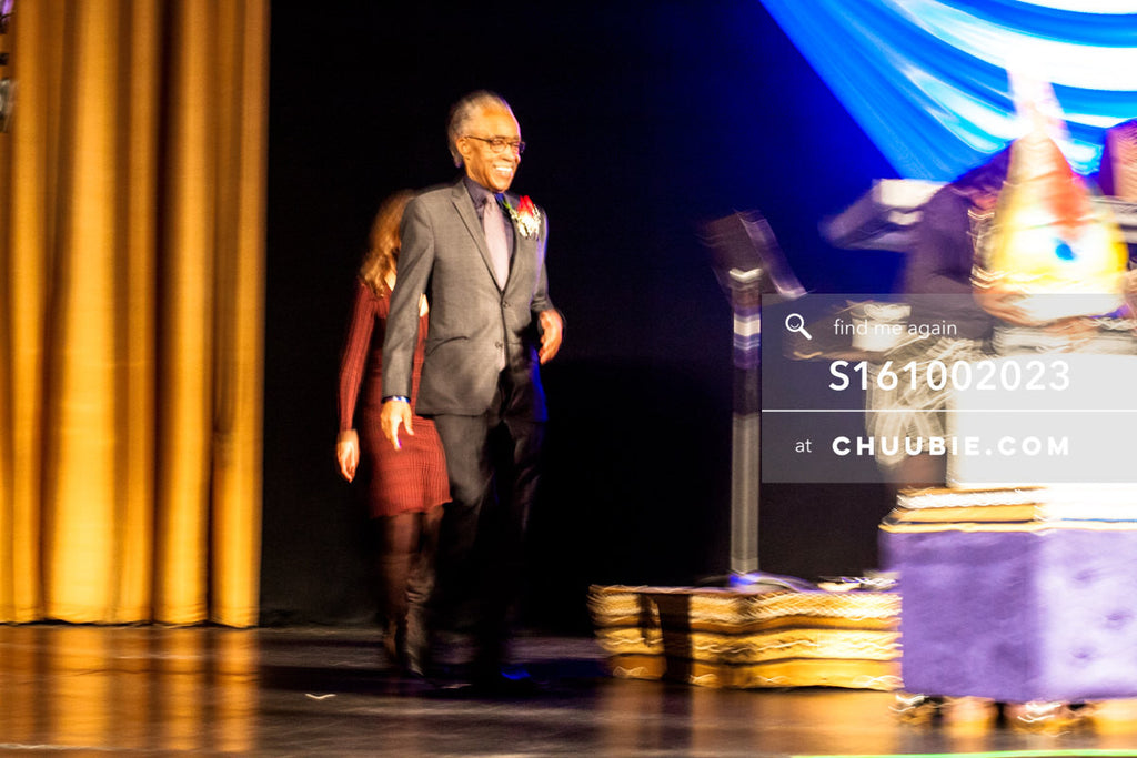 S161002023 | Reverend Al Sharpton walking on stage toward large cake, slight motion blur; photographed in New ... | Team Chuubie