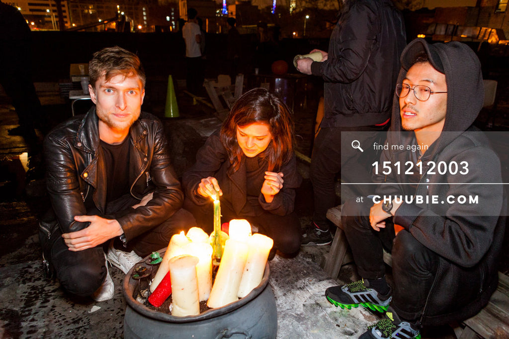 151212003 | Show attendees stay warm on the winter rooftop huddled next to candles. — Sublimate & Ruse La... | Team Chuubie