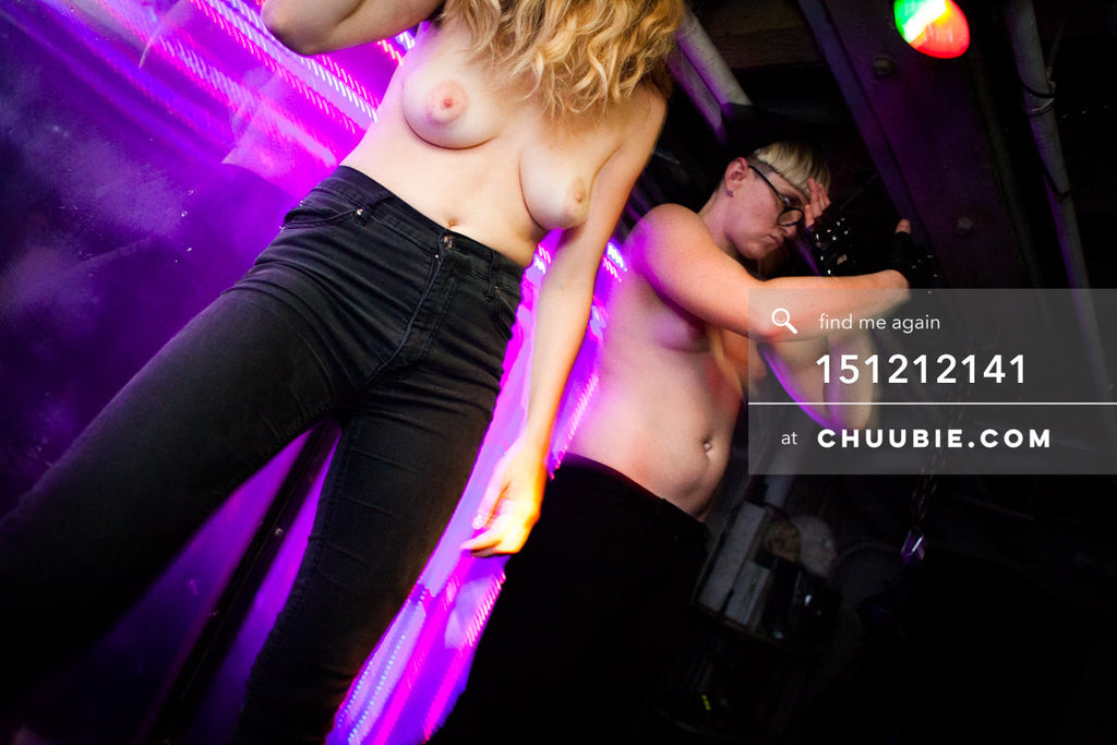 151212141 |  Topless queer female dancers on stage w/ magenta neon light at Brooklyn warehouse. — Sublimate &... | Team Chuubie