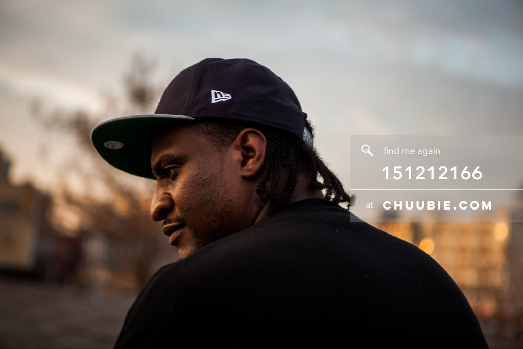 151212166 |  Close-up atmospheric portrait of our bouncer on Brooklyn warehouse rooftop at sunrise. — Sublima... | Team Chuubie