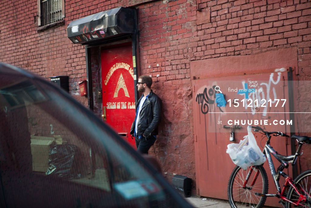 151212177 |  After the party: Brooklyn street scenes. Man waits by red door for the Outerspace Employment Age... | Team Chuubie