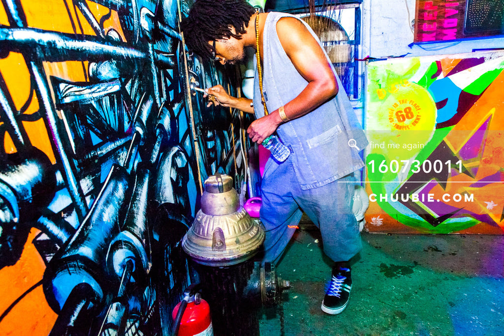 160730011 | DJ Turtle Bugg (Tajh Morris) opening a door against colorful graffiti at warehouse loft party. — ... | Team Chuubie