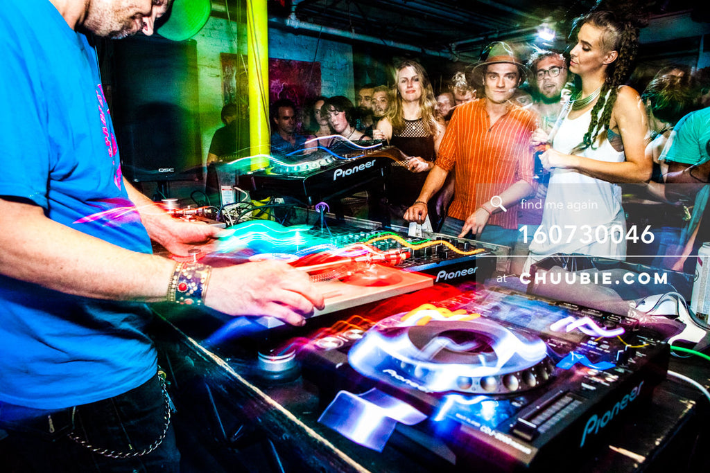 160730046 | Donny Burlin DJing with ladies dancing in Brooklyn warehouse rave floor crowd with light trails g... | Team Chuubie