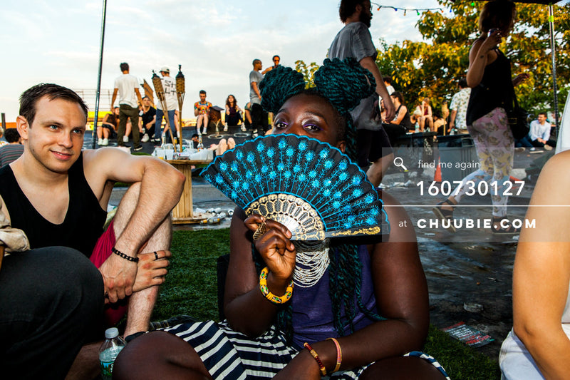 160730127 |  Tracy Boachie (DJ Akua) with turquoise fan on Brooklyn rooftop. — Sublimate & Ruse Labs pres... | Team Chuubie
